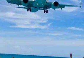 Saiba onde fica a praia em que aviões passam rasantes